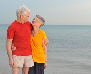 an older couple enjoying their vacation, and learning the benefits of vacationing