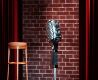 mic on a stage with a stool