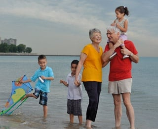 grandparents with grandkids on beach