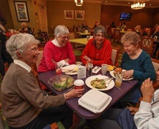 Senior friends eating dinner