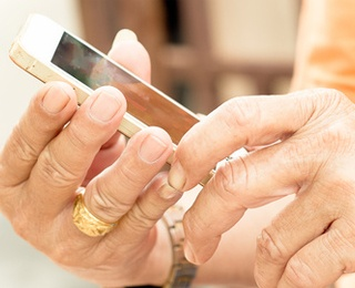 older woman handling a cell phone learning of the 10 smartphone exercise apps