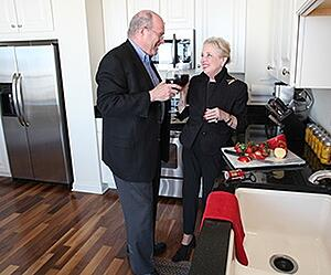 enjoying an appetizer with a spouse in the kitchen at a life plan community