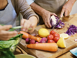 Older couple cooking together in the kitchen